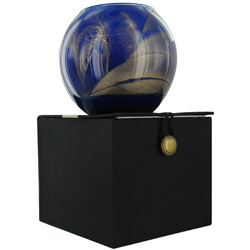 COBALT CANDLE GLOBE by Cobalt Candle Globe THE INSIDE OF THIS 4 in POLISHED GLOBE IS PAINTED WITH WAX TO CREATE SWIRLS OF GOLD AND RICH HUES AND COMES IN A SATIN COVERED GIFT BOX. CANDLE IS FILLED WITH A TRANSLUCENT WAX AND SCENTED WITH MYSTERIA. BURNS AP